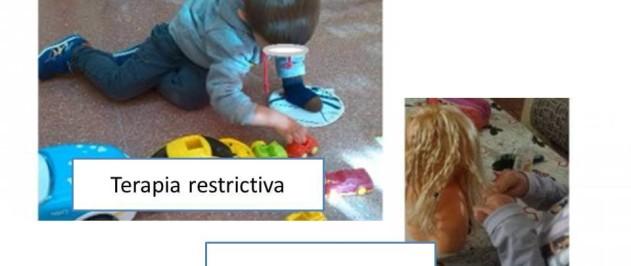 Terapia restrictiva  y bimanual