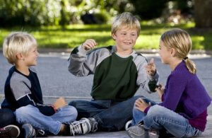 Kids-Sitting-and-Talking-300x195